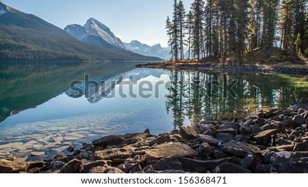 Morning sunlight at Maligne Lake, Jasper - stock photo