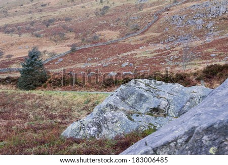 Morning sunlight lights the mountain top, Moorland winter landscape, Snowdonia, Wales, UK - stock photo