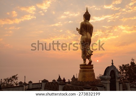Morning sunrise Buddha statue standing at Wat Phra That Khao Noi in Nan,Thailand