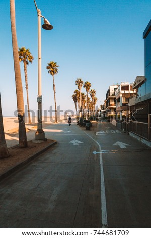 Morning sunrise lights at the Venice beach in Los Angeles. Bicycle lane by the beach.