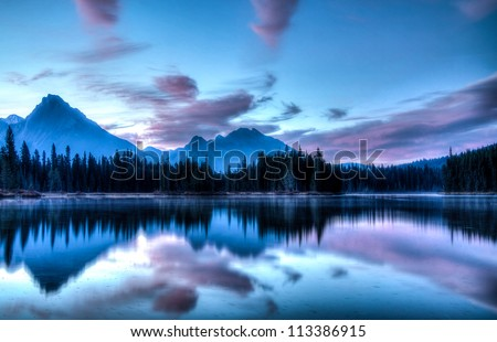 Morning sunrise over Spillway Lake in Kananaskis Country, Alberta, Canada. - stock photo