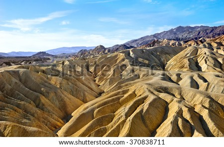Morning sunrise over Zabriskie Point in Death Valley National Park  - stock photo