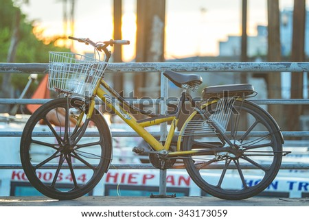 Morning sunshine at harbor and a standing bicycle. NAM DU island, VIETNAM. MAY 17, 2015 - stock photo