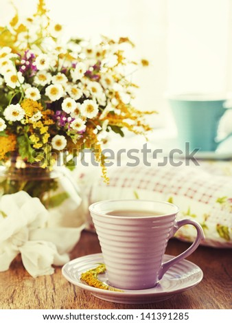 Morning tea and bright wild flowers - stock photo