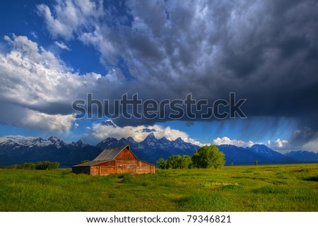 Morning thunderstorm passes over Grand Teton National Park and Moulton Barn, Mormon Row. - stock photo