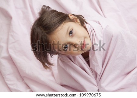morning time - happy girl in bed with pink pillow - stock photo
