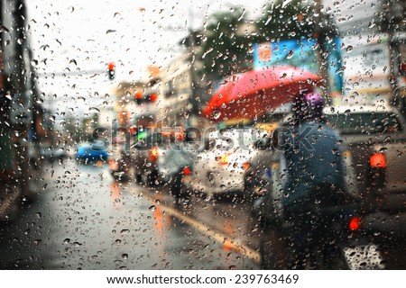 Morning traffic ,view through the window on rainy day - stock photo