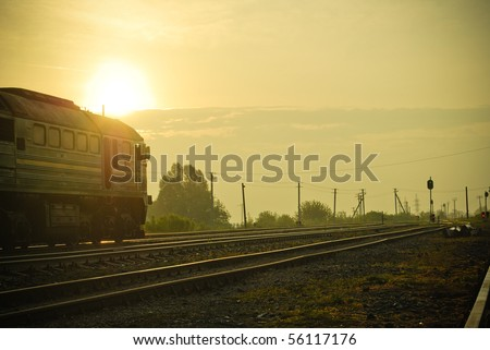 Morning Train Station: Rising Sun is Above the Train - stock photo