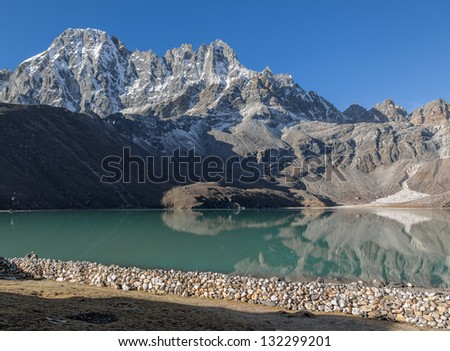 Morning view from the village of Gokyo on the lake Dudh Pokhari - Nepal, Himalayas - stock photo