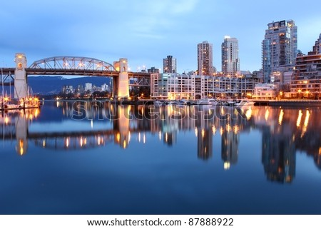 Morning view of a False Creek the West End condominiums and the historic Burrard Street Bridge in downtown Vancouver. British Columbia, Canada. - stock photo