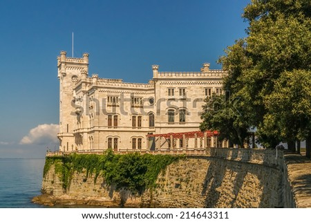 Morning view of Castle Miramare nearby Trieste against the blue sky and the blue sea - stock photo