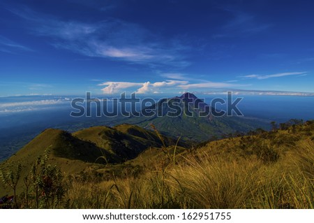 Morning view of Mount Merapi, View from Mount Merbabu Campsite, Central Java, Indonesia.  - stock photo