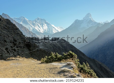 Morning view of the Ama Dablam and Mount Everest on background - Nepal, Himalayas - stock photo