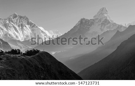 Morning view of the  Ama Dablam (6814 m) - Nepal, Himalayas (black and white) - stock photo