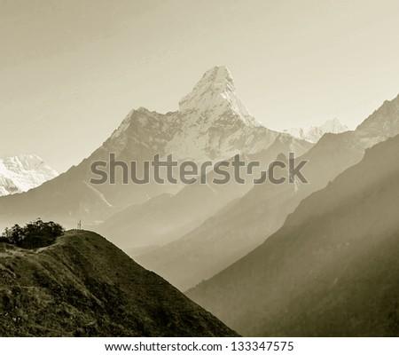 Morning view of the Ama Dablam (6814 m) - Nepal, Himalayas (stylized retro) - stock photo