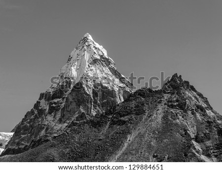 Morning view of the Chola (6069 m) in the area of Cho Oyu - Gokyo, Nepal, Himalayas (black and white) - stock photo