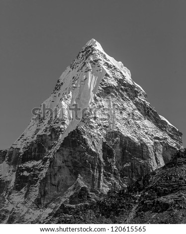 Morning view of the Chola (6069 m) in the area of Cho Oyu - Gokyo region, Nepal, Himalayas (black and white) - stock photo