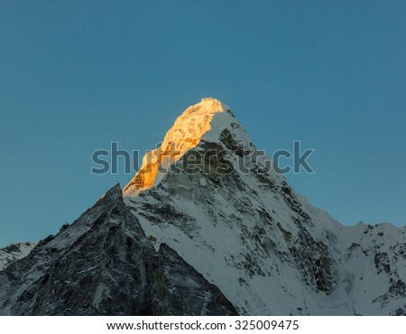 Morning view of the top of the Ama Dablam (6814 m) from the valley of the Chhukhung - Nepal, Himalayas