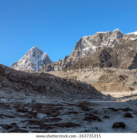 Morning view of the village of Kala Pathar from the North with Tabuche and Lobuche peaks on background - Nepal, Himalayas - stock photo