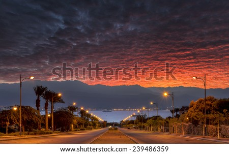 Morning view on a local street running to the Red Sea, Eilat, Israel - stock photo