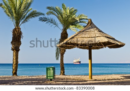 Morning view on the Aqaba gulf (Red Sea) from northern beach of Eilat, Israel - stock photo