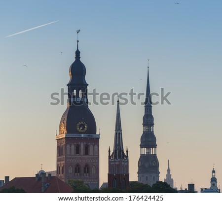 Morning view on the medieval churches in Riga, Latvia. In 2014, Riga city is the European capital of culture. - stock photo