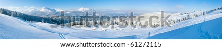 Morning winter calm mountain panorama with sheds group and mount ridge behind (Carpathian Mountains, Ukraine).  Five shots stitch image. - stock photo