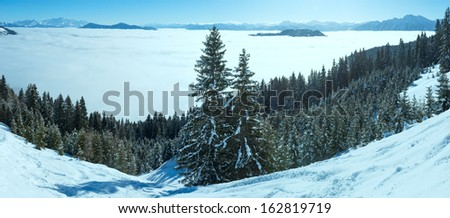 Morning winter mountain landscape with clouds in below valley (Hochkoenig region, Austria)