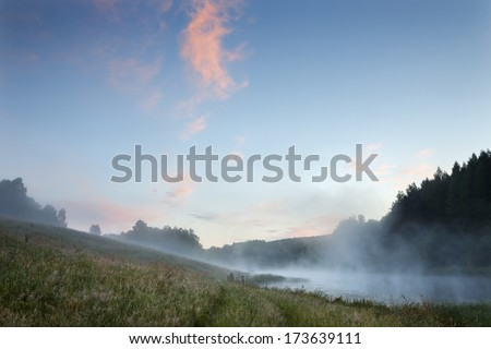 Morning with fog and lake in north Poland/Morning fog - stock photo