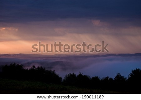 morning with fog and rain over hills dark landscape