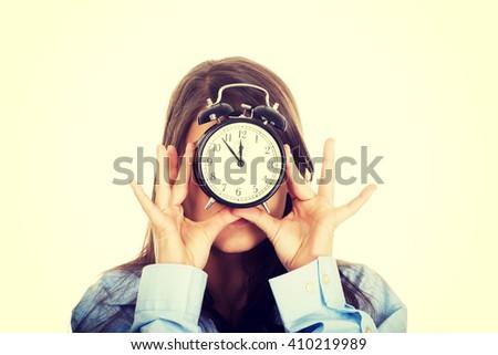 Morning woman in big shirt holding clock. - stock photo