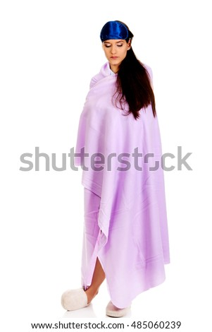 Morning woman wrapped in coverlet.
