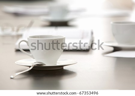 Morning workplace: cup of coffee and business objects on the table - stock photo