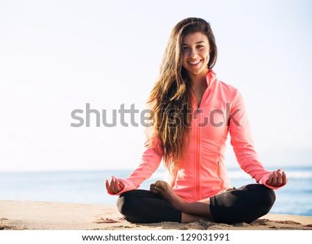 Morning Yoga Meditation by the Beach - stock photo