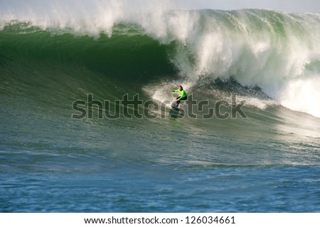 MORO BAY, CALIFORNIA-JANUARY 20:Zach Wormhoudt surfing on a classic wave during the Maverick Invitational Surfing event, January 20, 2013  in Moro Bay, California.