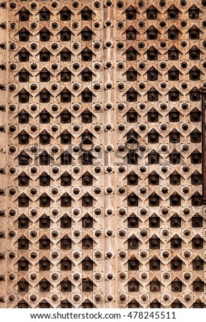 Moroccan antique wood texture door background with iron rings and bolts