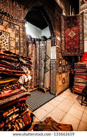 Moroccan Carpets in a street shop souk - stock photo