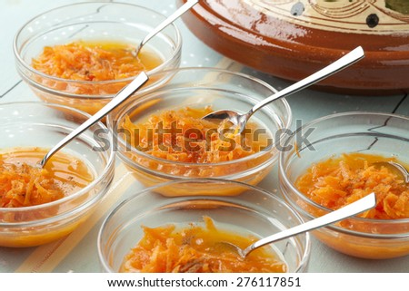 Moroccan carrop salade with orange juice and cinnamon, refreshing Moroccan summer drink  - stock photo