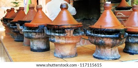 Moroccan ceramic cookware - tajines - stock photo