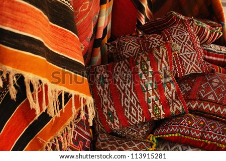 Moroccan cushions in a street shop in medina souk - stock photo