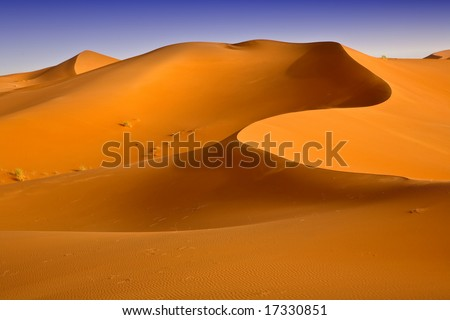 Moroccan desert dune background 03. Blue sky - stock photo