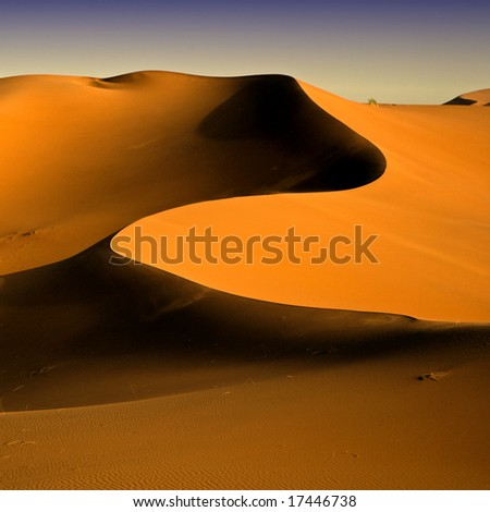 Moroccan desert dune background 04. Blue sky - stock photo