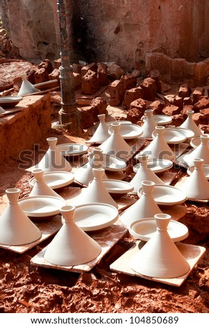 Moroccan dishware drying before roasting - stock photo