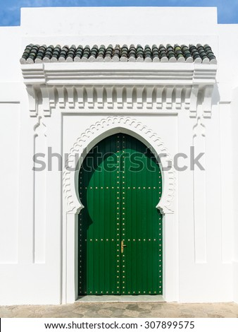 Moroccan door in the medina of Asilah, Morocco - stock photo