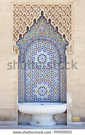 Moroccan fountain with mosaic tiles - stock photo