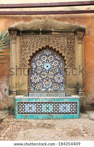 Moroccan fountain with mosaic tiles in the Andalusian Gardens of Rabat, Morocco - stock photo