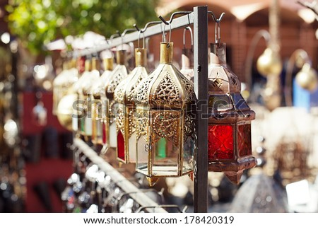 Moroccan glass and metal lanterns lamps in Marrakesh souq - stock photo