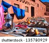 moroccan kettle and Colors of morocco towels and scarfs - stock photo