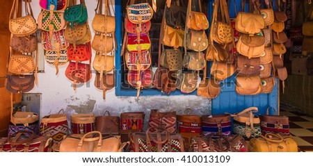 Moroccan leather goods bags in a row at outdoor market in Essaouira