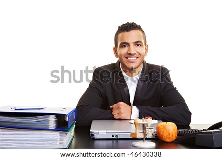 Moroccan manager sitting at his desk